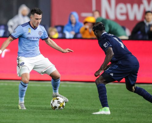 Sep 6, 2017; New York, NY, USA; New York City FC midfielder Jack Harrison (11) controls the ball as Sporting Kansas City defender Ike Opara (3) defends during the first half at Yankee Stadium. Mandatory Credit: Vincent Carchietta-USA TODAY Sports